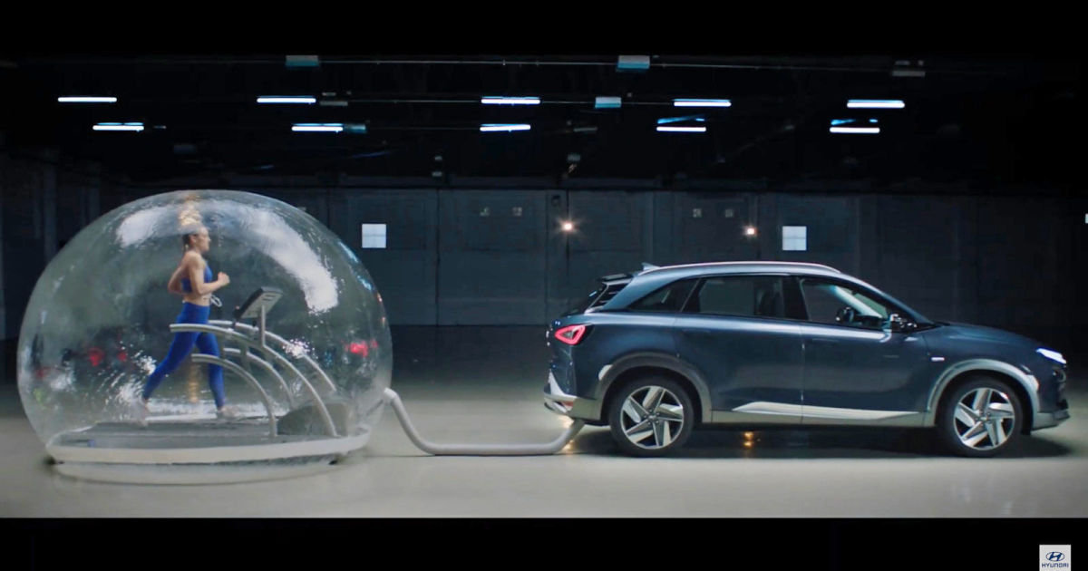 Watch an Olympian run in a bubble full of hydrogen car emissions